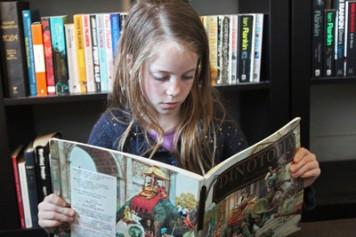 child reading comics